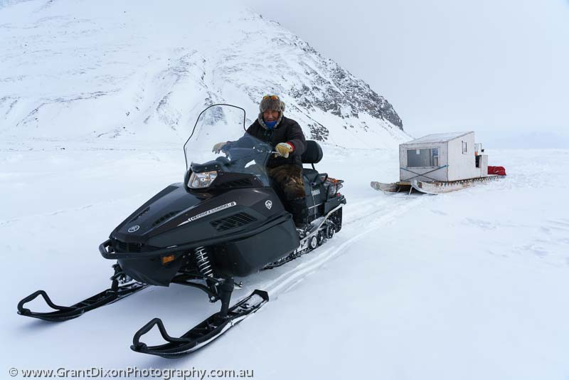 image of Inuit on snowmobile