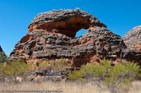 AUSTRALIA, Western Australia, East Kimberley, Purnululu National Park (Bungle Bungles). Layered sandstone dome with eroded arch.