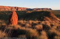 AUSTRALIA, Western Australia, East Kimberley, Purnululu National Park (Bungle Bungles). Termite mound & sunset on western escarpment of Bungle Bungle Range.