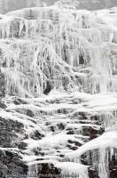 AUSTRALIA, Tasmania, Franklin-Gordon Wild Rivers National Park. Icicles on quartzite rock cliff at Frenchmans Cap, winter.