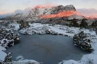 AUSTRALIA, Tasmania, Cradle Mountain - Lake St Clair National Park. Dawn light on east face of Cradle Mountain, with autumn snow.