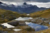 NEW ZEALAND, Fiordland National Park. Three tarns, Mt Solitary beyond, Heath Mountains.