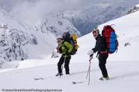 INDIA, Uttaranchal, Govind National Park. Skiers above Rupin valley