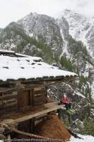 INDIA, Uttaranchal, Govind National Park. Trekker/skier at seasonal-use hut, Rupin valley.