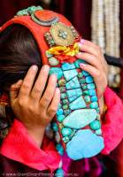 Woman in traditonal costume, with turquoise-decorated headgear, Ladakh Festival, Leh, 2013