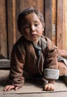 Child in doorway, Manaslu Circuit trek, Nepal