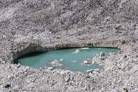 Meltwater pool on Salpudanda Glacier, Manaslu Circuit trek, Nepal