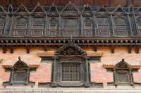 NEPAL. Bhaktapur, Kathmandu valley. Carved wooden windows on facade of 55 Window Palace, Durbar Square.