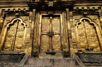 NEPAL, Kathmandu valley. Gilded door & windows, Changu Narayan Temple.