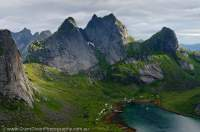 NORWAY, Nordland. Lofoten Islands, Moskenesoy. Glaciated granite peaks above Kjerkfjord.