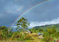 Rainbow over Bakonabip vilage, below the Hindenburg Wall, Papua New Guinea.