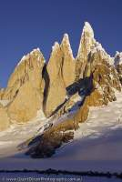 ARGENTINA, Patagonia. Granite spires of Cerro Torre and subsidiary peaks at head of Circo de los Altares, sunset.
